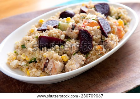 beet salad with quinoa and chicken. A protein rich, healthy meal - stock photo