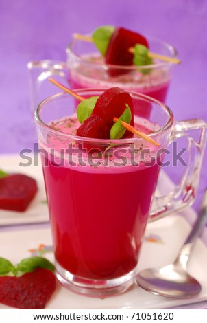 beet soup with cream (  red borscht ) in glass decorated with heart shaped slices - stock photo
