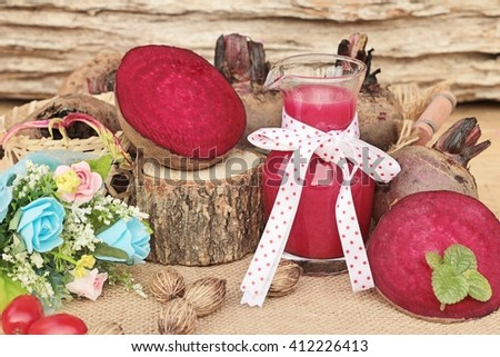 Beetroot juice and fresh beetroot is delicious - stock photo