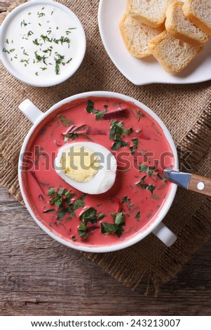 Beetroot soup with egg close up. Vertical view from above  - stock photo