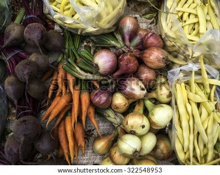 Beets, onions, carrots and green beans at the farmers market - stock photo