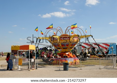 BEEVILLE, USA - OCT 19: Carousel in the amusement park. October 19, 2008 in Beeville, Texas, USA - stock photo