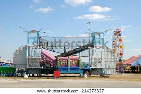 BEEVILLE, USA - OCT 19: Children playing in the amusement park. October 19, 2008 in Beeville, Texas, USA - stock photo