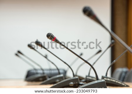 before a conference, the microphones in front of empty chairs.Selective focus. - stock photo