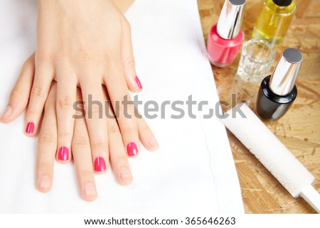 Before and after woman nails treatment in Nail Salon - stock photo