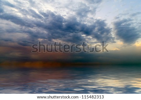 Before sunrise on the sea there is a calm, and on  horizon the storm root. - stock photo