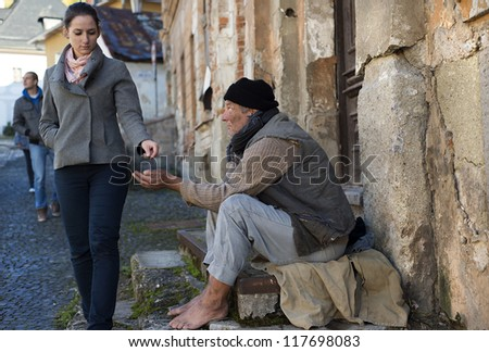Begging man on the street - stock photo