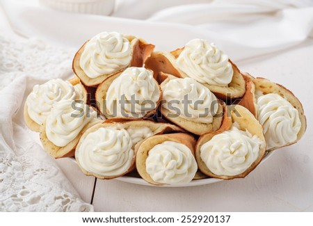 Beghrir - pancakes with custard or whipped cream on wooden table. Eastern cuisine. Oriental sweets - stock photo