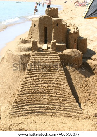 Begin your holidays in the sand castle on the beach - stock photo