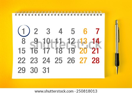 Beginning of the month, Paper Calendar Page with Spiral Binding with pencil stroke around the first day of the month. - stock photo