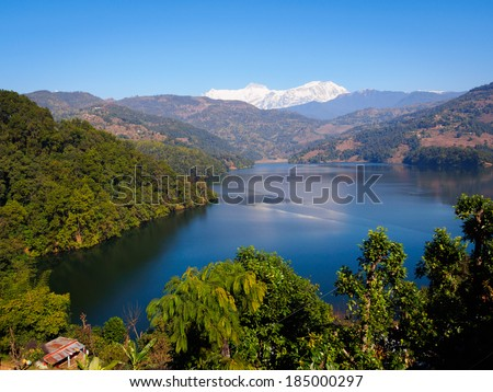 Begnas Tal, Nepal with the Annapurna Himalaya visible in the background - stock photo