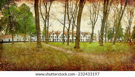 Beguinage - monastery (Begijnhof) Fall park in Bruges, Belgium. Photo in retro style. Paper texture. Aged textured photo in retro style - stock photo