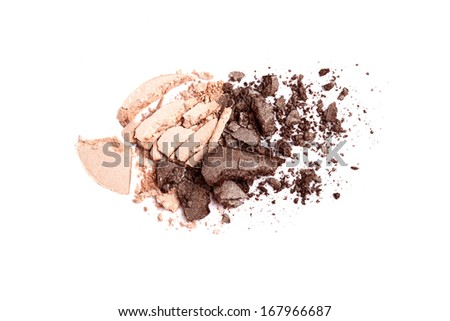 Beige and brown crushed eyeshadow on white background - stock photo