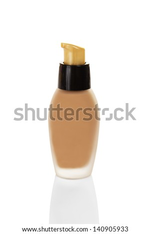 Beige basis for a makeup, isolated on white - stock photo
