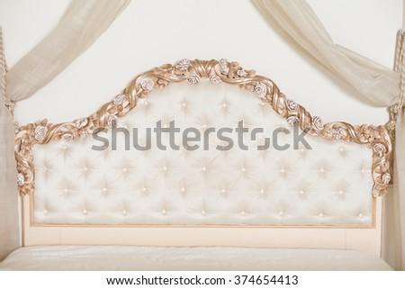 Beige beautiful bedhead - stock photo