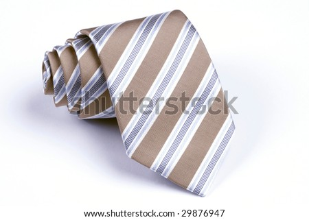 beige, blue and white striped necktie rolled up on white background - stock photo