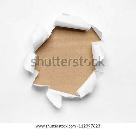 Beige circle shape breakthrough paper hole with white background - stock photo