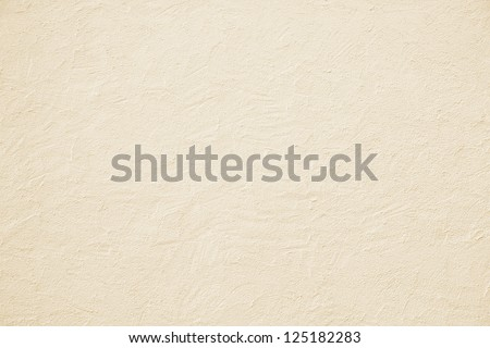 beige colored house front, structured with spatula techniques, background design - stock photo