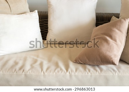 Beige cushions on wrinkled couch - stock photo
