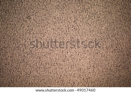 Beige dotted leather surface (vignetted) - stock photo
