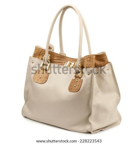 Beige female handbag isolated on white background. - stock photo