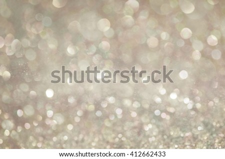 Beige glow glitter background. Elegant abstract background with bokeh  - stock photo