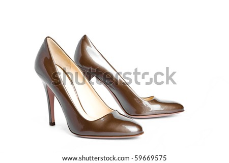 Beige-golden female new varnished shoes on high heel-stiletto - stock photo