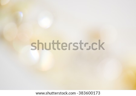 Beige ivory background with soft glowing lights and beautiful bokeh with shine lights. Backdrop for wedding cards  - stock photo