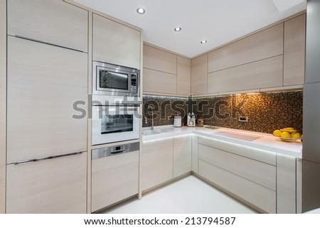 Beige kitchen interior - stock photo
