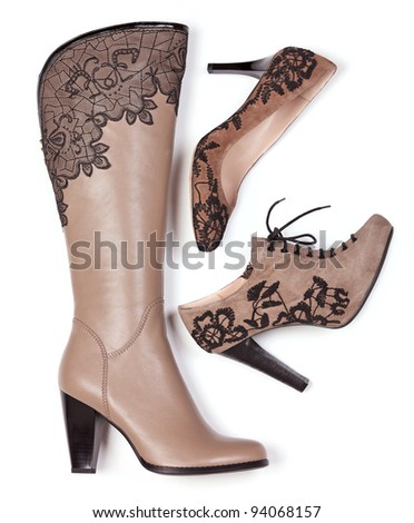 Beige knee-high boot, suede ankle-high boot and pump with floral pattern - stock photo