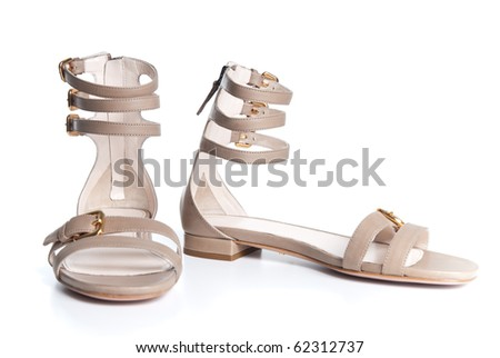 beige leather female sandals isolated on white - stock photo