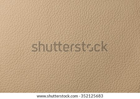 Beige leather texture from car seats on background - stock photo