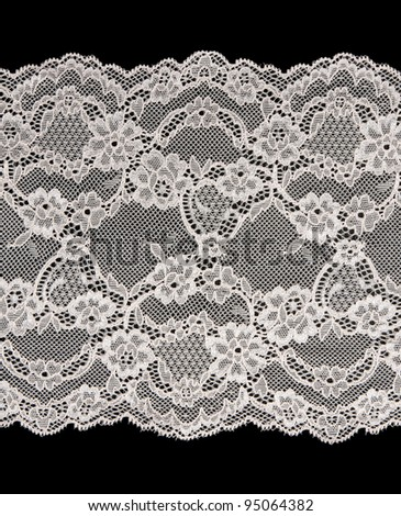 Beige openwork lace isolated on a black background - stock photo