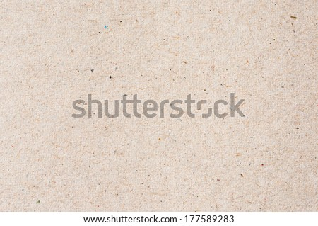 beige paperboard with small colorful sprinkles - stock photo