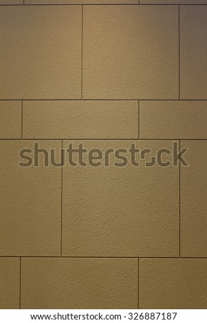 Beige peeled brick wall with square form - stock photo