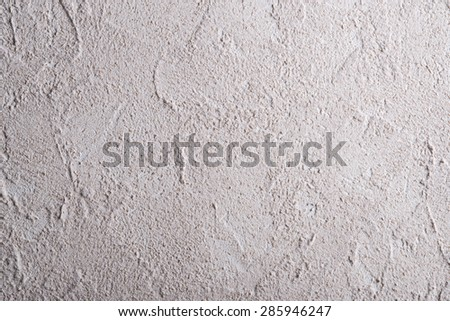 Beige wall stucco texture as background - stock photo