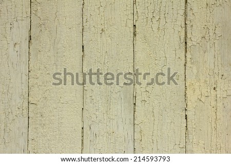 beige wooden planks with peeling old paint, texture - stock photo