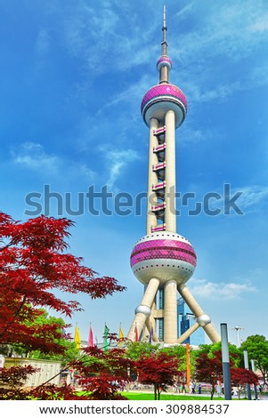 BEIGING, CHINA- MAY 24, 2015: Oriental Pearl Tower on  blue sky background. Tower 470 meter the Oriental Pearl is one of Shanghai's tallest buildings. - stock photo