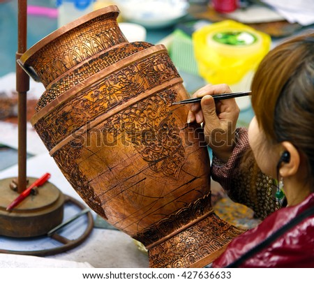 BEIJING - April 11, 2016: An artisan in China Making Cloisonne. The making of Cloisonne involves quite elaborate and complicated processes. - stock photo
