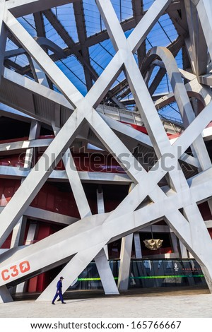 BEIJING - APRIL 12. Bird's nest at day time at Apr. 12, 2011. The Bird's Nest is a stadium in Beijing, China. It was designed for use throughout the 2008 Summer Olympics and Paralympics.  - stock photo
