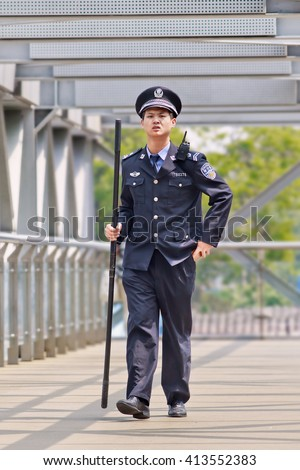 BEIJING-APRIL 28, 2016. Policeman with baton. Beijing police have significantly stepped up security measures, deployed more than 1,300 armed police officers and 150 patrol vehicles throughout the city - stock photo