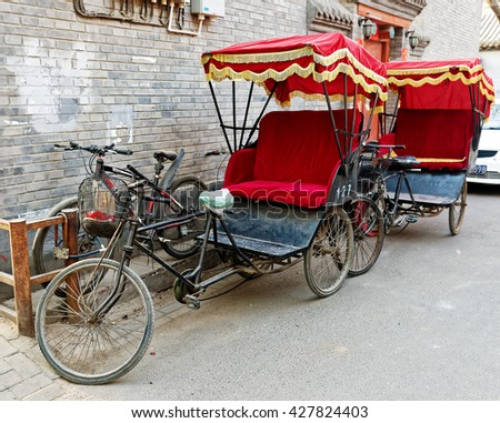BEIJING - April 10, 2016:Typical Chinese rickshaw padicab, traditional transportation. Since the 1950s, when the pulled rickshaw was phased out, passengers may travel using three-wheeled pedicabs. - stock photo