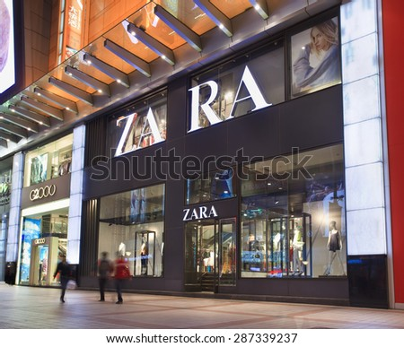 BEIJING-APRIL 14, 2013. Zara outlet at night. Zara owner, Spain Inditex, has reported annual profits of $2.6 billion which is up 11% on the previous year. Inditex has now 5,527 stores worldwide.  - stock photo
