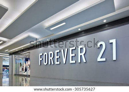 BEIJING-AUG. 2, 2015. Forever 21 outlet. The US fast fashion brand Forever 21, founded in 1984 and entered China in 2012, is quickening its expansion in China with plans to open more stores this year. - stock photo