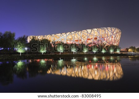 BEIJING - AUGUST 16: Bird's nest stadium at night time on August 16, 2011 in Beijing, China. It was designed for 2008 Summer Olympics and Paralympics. - stock photo