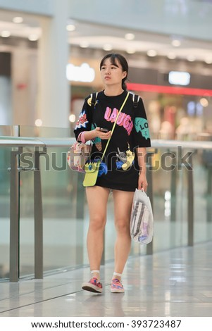 BEIJING-AUGUST 19; 2015. Casual dressed girl at Livat mega mall. Owned by Inter IKEA Center Group; its unique Scandinavian design interior houses over 400 renowned domestic and international brands. - stock photo