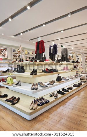 BEIJING-AUGUST 21, 2015. Hotwind outlet interior. It is a well-known fast-growing retail brand with more than 90 chain stores in Chinese cities and 1500 people to operate various types of footwear. - stock photo