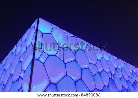 BEIJING - AUGUST 28. Surface of Beijing Olympic Water Cube at night time on August 28, 2011. It hosted swimming  events. Its capacity was 17000m2 and is reduced to 6.000 after the Olympics. - stock photo