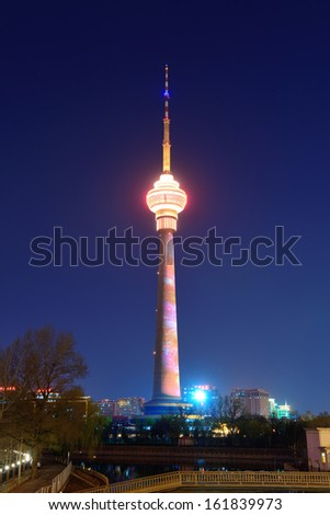 BEIJING, CHINA - APR 6: Central Radio & TV Tower at night on April 6, 2013 in Beijing, China. It is the tallest architecture in Beijing and member of the World Federation of Great Towers.  - stock photo