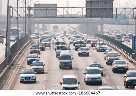 BEIJING, CHINA - APRIL 2: a lot of cars drive at The North 4th Ring Road Middle on April 2, 2013 in Beijing - stock photo